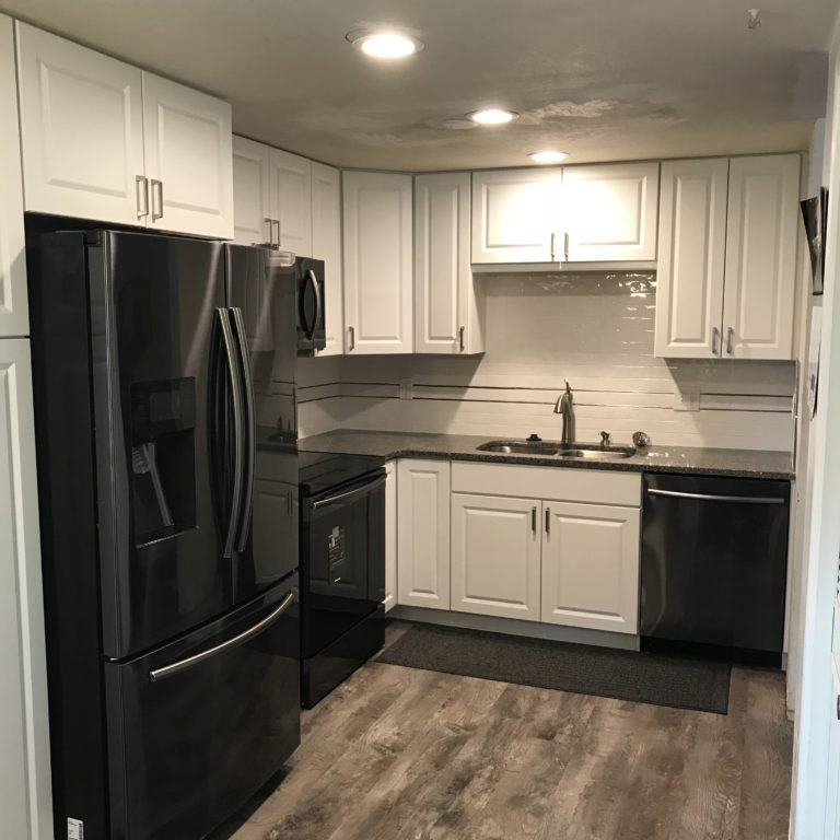 Remodeled Kitchen With White Cabinets